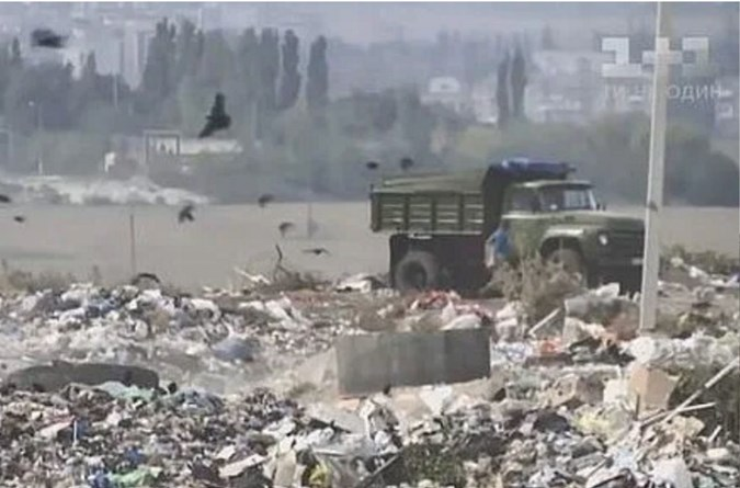 Ukraine landfill that is home to the 12-year-old mother