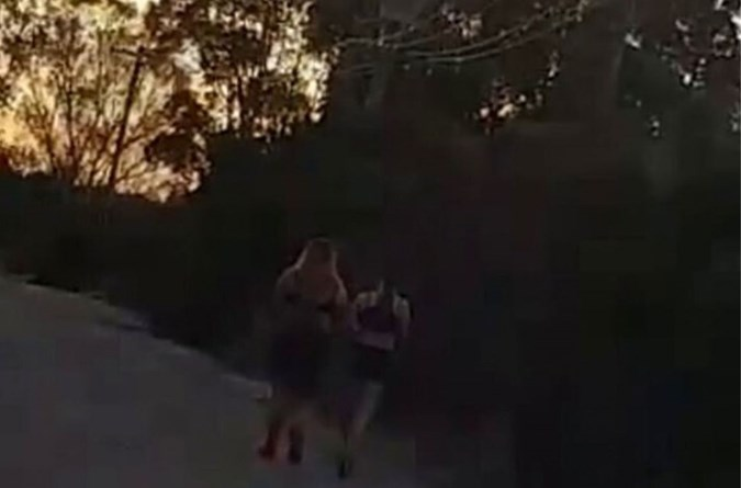 Shocking footage shows the bizarre moment the man confronted the girls, who claimed they had to burn their clothes on the side of the road. Image: Facebook